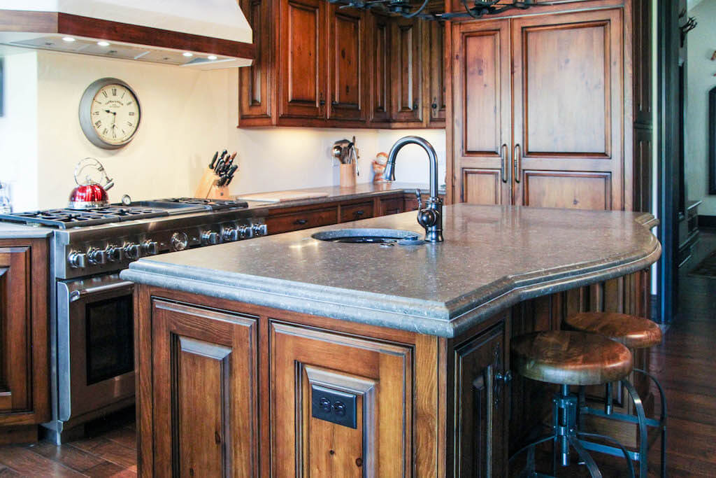 dark custom cabinetry in an updated kitchen