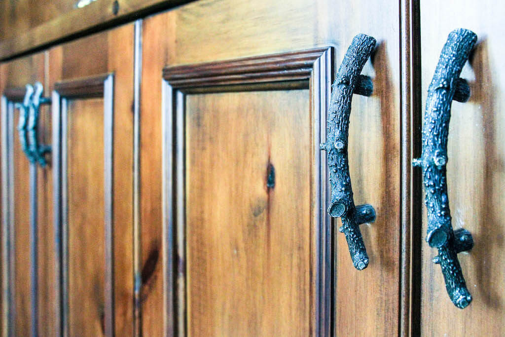 close-up of detailed cabinet handles, made to look like sticks