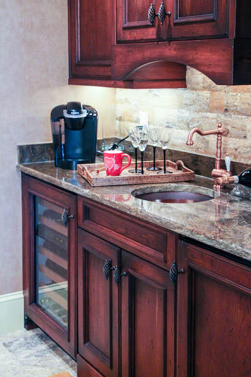wet bar with copper faucet and under counter wine fridge