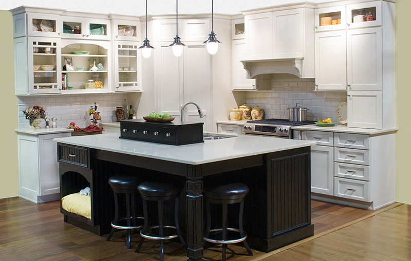 large white cabinets offset by black island with tuck-under stools