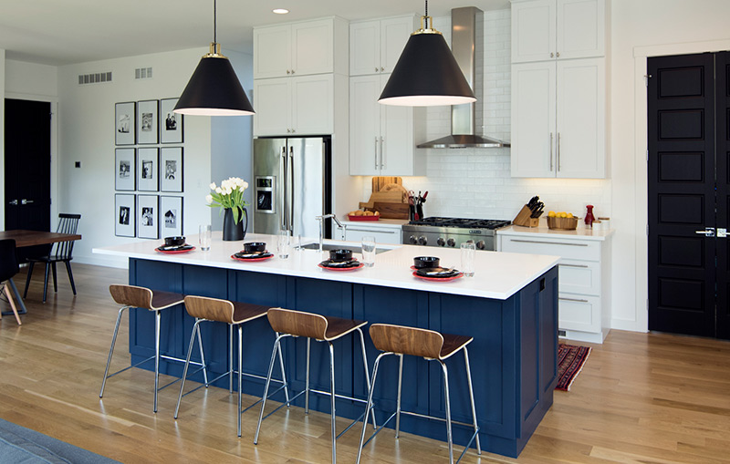 white cabinets in an open concept kitchen, with blue island as accent